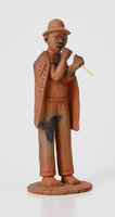 Figurine of a man playing lekolilo pipe