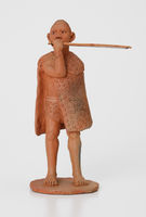 Figurine of a man  playing lesiba