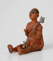Figurine of a man playing seketari