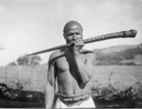 A Venda playing upon a phalaphala made from gemsbok horn