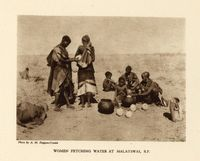 Women fetching water at Malatswai, B.P.
