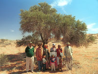 "Karel ""Vet Piet"" Kleinman and members of the -Kassie Family stand in front of the Tree of Family."