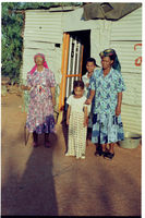 Lena Booysen and her family outside their Andriesvale, Northern Cape, South Africa home