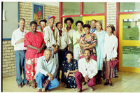 Members of the San community pose for a photograph in an unidentified primary school.
