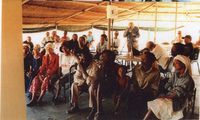 San community members attend a meeting at the Molopo Kalahari Lodge