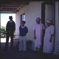 Andries Olyn and his family outside their home
