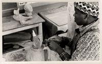 Billy Mandindi producing a ceramic sculpture