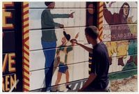 Joseph Gaylard and students working on a public mural
