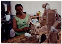 Child care educator making a toy sculpture