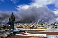 Homes set alight by vigilantes, Crossroads, Cape Town, South Africa