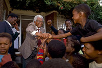 Walter Sisulu with children after his release from prison, Soweto, South Africa