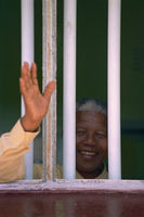 Mandela waving from former prison cell, Robben Island, South Africa