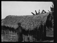 Young boy outside his hut in a boys' village