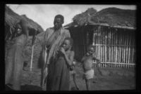Family outside their hut