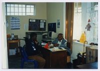 David Vithi assists a disabled advice seeker at the Cape Town A[dvice] O[ffice], 1993