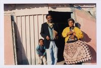 Jeffrey Nongwe 'Traditional leader' with his wife outside their home in Section IV