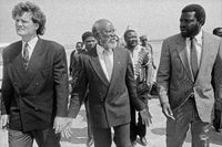 Andimba Toivo ya Toivo, Hage Geingob and other SWAPO leaders arrive from exile and are met by Anton Lubowski