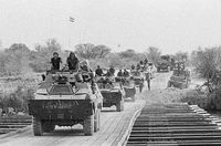 Convoy of Ratel 20s and 90s from the 61st Mechanised Battalion crosses the South African Defence Force (SADF)-built pontoon bridge over the Kavango River