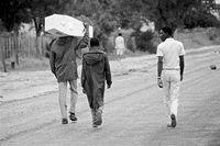 Carrying an empty coffin, Rundu