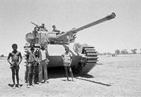 Herders meet with the crew of an Olifant tank