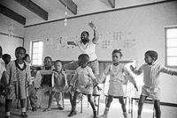 Willie Amutenya leading children in a dance