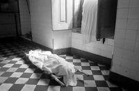 Body of a refugee in a corridor of the Josina Machel Hospital, Luanda, Angola