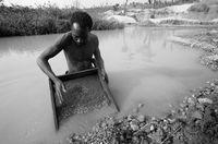Garimpeiro panning for diamonds, Lunda Norte, Angola