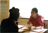 Volunteer Pauline Marais advises client, Port Elizabeth Advice Office, Dec 94