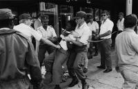 Police arrest student during protest, Durban, 1985