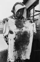 Mother holding bloodstained shirt, Tembisa township, Transvaal, 1985