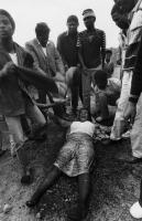Woman overcome by tear gas at funeral, Port Elizabeth, 1986