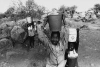Children fetching water, Dinokana, South Africa, circa 1980