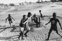 Children pumping water, Phokeng, South Africa, 1980