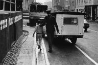 Child being arrested by policeman, Cape Town, South Africa, 1982