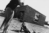 Child being caned, Ditsaneng, South Africa, 1981