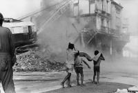 Boys watching destruction of District Six, South Africa, 1974