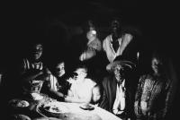 Family at dinner table, Bela Bela township, South Africa, circa 1995
