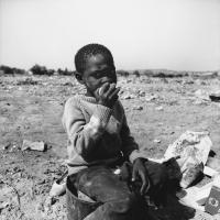 Child in rubbish dump, Winterveld, South Africa, 1981