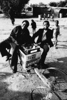 Milk delivery boys, Crossroads, South Africa, 1982