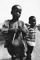 Young boy with home-made drum, Mooiplaas, South Africa, 1997