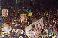 ANC [African National Congress] supporters celebrate after Nelson Mandela wins the Presidency