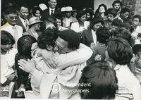 Allan Boesak hugs a member of his congregation, Cape Town