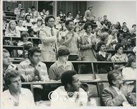 Allan Boesak applauds at a lecture, Cape Town