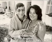 Apartheid era: mixed marriages. A husband and wife outside their house , Cape Town