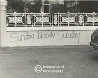 "Someone spray-painted ""Sunday bloody Sunday"" on a wall, Cape Town"