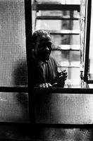 Kippie Morolong Moeketsi, looking through window, Johannesburg, South Africa