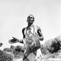 Xhosa man beating a drum, Transkei, South Africa