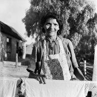 Portrait of a woman wearing an apron, Genadendal, South Africa
