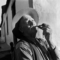 Elderly man smoking his pipe, Genadendal, South Africa