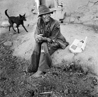Man sitting on the ground, Genadendal, South Africa